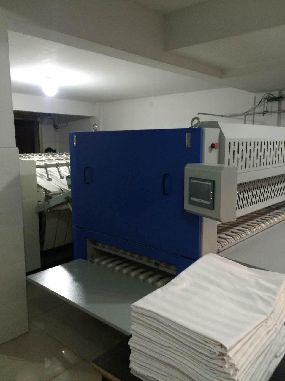 鸿运国际烫平机洗衣房应用案